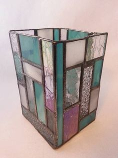 4x4x7in. Hurricane stained glass candle holder holds medium size pillar candle or smaller.
