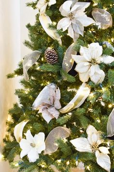 How to Put Ribbon on a Christmas Tree - Monica Wants It % Use poinsettia flowers and ribbon garland to decorate a Christmas tree in this easy DIY tutorial on how to put ribbon on a tree. A tutorial on how to easily add ribbon garland to a Christmas tree. Christmas Tree Decorations Ribbon, Christmas Tree Decorating Tips, Ribbon On Christmas Tree, Christmas Tree Design, Beautiful Christmas Trees, Christmas Tree Themes, Christmas Tree Toppers, Christmas Tree Poinsettia, Door Decorating