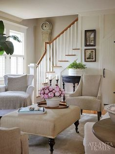 another favorite living room - and I adore the linen coffee table ottoman!