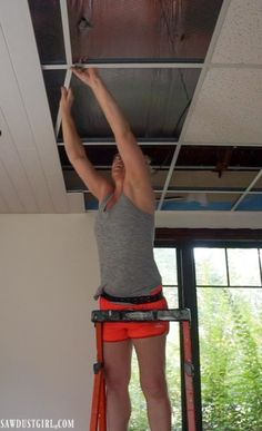Installing WoodHaven Planks and Hiding Ugly Drop Ceiling Grid! - Sawdust Girl® Install plank ceilings ON a suspended, drop ceiling grid! Drop Ceiling Basement, Drop Ceiling Grid, Drop Ceiling Tiles, Drop Down Ceiling, Plank Ceiling, Dropped Ceiling, Ceiling Panels, Ceiling Decor, Ceiling Ideas