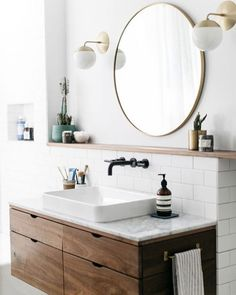 Modern Bathroom with Round Mirror (Plus, where to find the Round Mirror at every price + why they look so great in every space!) Click through for the details. | glitterinc.com | @glitterinc