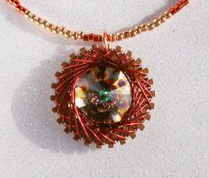 Spirograph Inspired Design, Wire Wrapped Swarovski Crystal Rivoli Necklace, Peacock by SparkleBunnyFrouFrou on Etsy