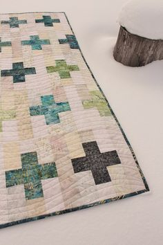"""This weekend I make a few more Plus block for Laila's Low Volume Plus Sew Along and made a baby quilt with them. I added a 2 1/2"""" strip of background between each block and offset the rows.    I qui"""