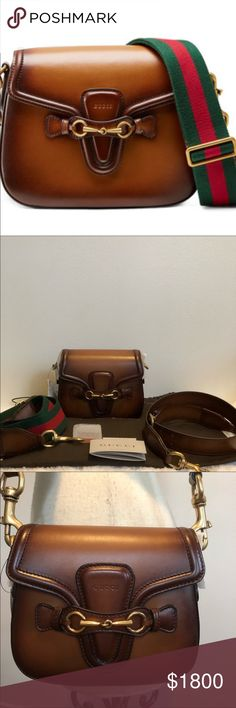 Gorgeous Gucci Lady Webb in brand new condition! Beautiful Gucci Lady Webb in whiskey leather!! 2 interchangeable straps and dust bag included! JUST GORGEOUS! No scratches no marks AT ALL! Gucci Bags Crossbody Bags