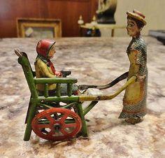 Vintage Antique Litho Tin Penny Toy Meier Woman Child Push Cart