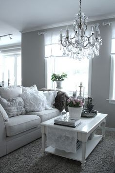 I have fallen in love with grey walls, chandelier, and white lace accents.