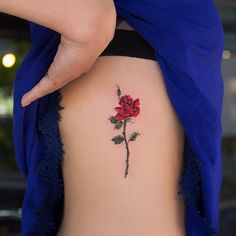 Colored rose tattoo on ribs by robcarvalhoart