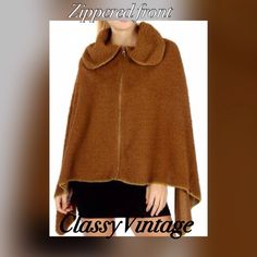Zippered front cape in rusty brown. NWT Beautiful faux sheering look! Zippered front or leave it open. Fluffy and warm Boutique Jackets & Coats Capes