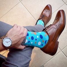 Show off your personality with a slightly exposed colorful sock.