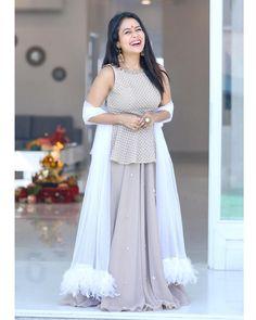 Image may contain: 1 person, standing Neha Kakkar Dresses, Lehnga Dress, Cape Lehenga, Lehenga Skirt, Party Kleidung, Indian Designer Suits, Kurti Designs Party Wear, Stylish Girl Pic, Indian Beauty Saree