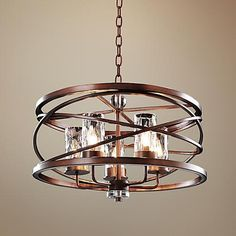 With a handsome Etruscan bronze finish, water glass shades and candelabra bulbs, this 5 light chandelier has a look that's both modern and timeless.