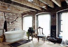 I forgot how much I LOVED this bathroom until @Jimmy Stanton just pinned it!  Everyone needs giant antlers over a soaking tub in a bathroom big enough to park a Suburban.  This is my dream bathroom.