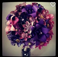 Paper bouquet origami wedding flowers.  Purple. Cadbury. Pink. Fuchsia. Roses, lilies, lily, kusudama.  Wedding flowers by Lily Belle Keepsakes Contact: lilybellekeepsakes@gmail.com  www.lilybellekeepsakes.com www.instagram.com/lilybellekeepsakes www.facebook.com/lilybellekeepsakes