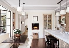 white kitchen with timber accents and black hardware
