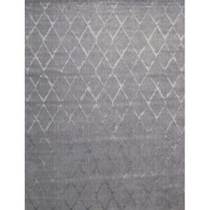 Featuring a diamond trellis print in grey tones, this handmade wool and art silk rug lends a touch of pattern to your living room or entryway.