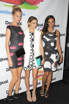 These stylish stars were all smiles for Desigual's lively show and even dressed for the occasion in their assorted printed frocks. Poppy Delevingne, Olivia Palermo and Rosario Dawson