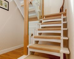 Staircase treads and sub risers painted white and then the steps are part carpeted. Click to see more.