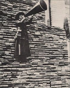 1910 - A lady announcing more books to be donated to NY public library.