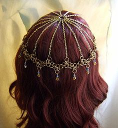 Check out this headdress! Stuff of fairy tales, I tell you! I would add more color. And beads. And overall gorgeousness. It would be amazing.