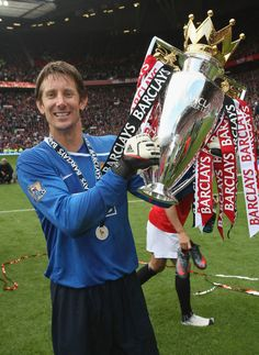 Edwin van der Sar of Manchester United celebrates with the Premier League trophy after the Barclays Premier League match between Manchester United and Arsenal at Old Trafford on May 16 2009 in. Get premium, high resolution news photos at Getty Images Manchester United Champions, Manchester United Players, Manchester United Old Trafford, Manchester England, John Peter, Barclays Premier, Barclay Premier League, Premier League Matches, Man United