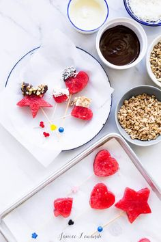 Frozen watermelon pops dipped into melted chocolate and granola or other fun toppings - a super fun 4th of july dessert recipe that makes a great frozen treat just like homemade popsicles but better and easier! Cut out maple leafs for a Canada Day dessert recipe.