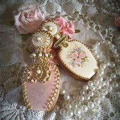Perfume bottle cookies in pink, gold, roses, pearls. Cookie artist, Teri Pringle Wood