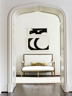White Antique Settee with modern artworks