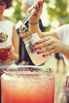 How fun would it be to serve pink lemonaide this way at a cookout?