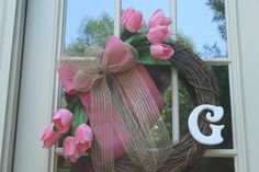 "Our Lovely HANDmade ""Hand Sprayed Pink Tulip"" Grapevine Wreath would make a wonderful addition to any home with its pink flowers and burlap bow bringing the beauty of spring and summer to your home year round. This wreath would be a perfect welcome to my home decor. or on a wall to bring the beauty of flowers indoors for daily enjoyment. Handmade with an 18 inch grapevine wreath, artificial pink tulip flower bunches, pink and natural burlap ribbon, and white wooden personalized letter."