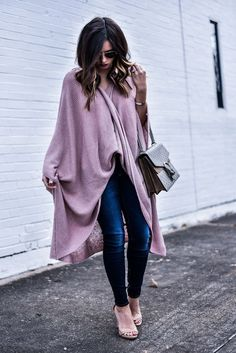 Tiffany Jais the Houston style blogger of Flaunt and Center wearing a wrap poncho from anthropology and dark wash skinny jeans with steve madden heels, and a gucci bag   what's trending in fashion