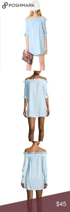"""🆕MinkPink Business Class Off Shoulder Dress NWT Business Class dress by MinkPink. Beautiful light blue color. Buttons up the entire front. Roll tab sleeves. Cute ruffle off shoulder detail. There is a wide elastic band across the top for maximum comfort and movement. An extra button is included.   Size Small. 29"""" long and 17.5"""" across bust. MINKPINK Dresses Mini"""