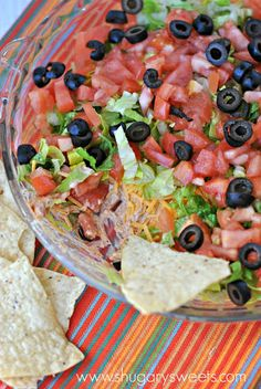 Healthy Taco Dip With Plain Greek Yogurt, Taco Seasoning, Roma Tomatoes, Romaine Lettuce, Sliced Black Olives, Shredded Reduced Fat Cheddar Cheese, Tortilla Chips