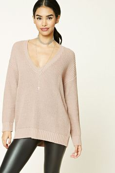 Crafted from a chunky knit, this sweater features a longline silhouette, a V-neckline, long sleeves, and ribbed trim.