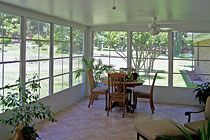 Eze-Breeze Patio Enclosure - Rusk, TX: Removed existing patio cover; poured additional concrete slab; installed insulated roof and PGT Eze-Breeze vinyl window system with insulated knee wall; finished interior with ceramic tile flooring.