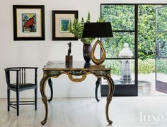 White and Black Eclectic Living Room with Antique Table
