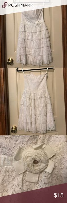 White size small ruffled delia's dress White size small Delia's dress. It is strapless and has adorable ruffles on it and lace. Cute flower accent on the side. *smoke free home delia's Dresses Strapless