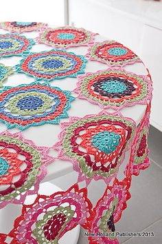 Tejidos - Knitted 2 - Gypsy Cascade Tablecloth pattern by Natalie Clegg - this pattern is from a book BUT you may choose your favorite doily pattern, make a few in all the left over colors in view and just like that add a festive touch to a simple table! Crochet Simple, Love Crochet, Crochet Granny, Crochet Motif, Crochet Doilies, Crochet Flowers, Knit Crochet, Crochet Tablecloth Pattern, Ravelry Crochet