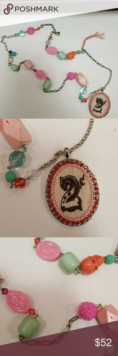 Tarina Tarantino 2 cent Circus Necklace Long Silver Chain with wood beads, cameo beads, skulls, roses with medallion of fabric stitched with 2 cent and pink Sworvaski crystal and ribbon tie. Claw clasp Tarina Tarantino Jewelry Necklaces