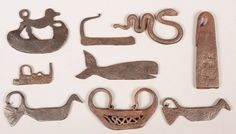 """Sold $900 Nine Various Wrought Iron Strikers. Including Whale, snake, dog, bird and boat form, 2-1/4"""" to 4-1/2""""l. Condition: Good with use wear."""