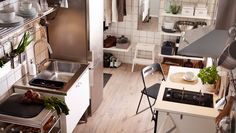 Modern white kitchen with HÄGGEBY fronts and free-standing units