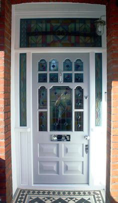 Front door with stained glass panels, painted in F&B Cornforth White  www.thehampshiredoorcompany.co.uk