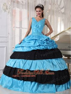 Pretty Light Blue and Black Quinceanera Dress V-neck Taffeta Beading Ball Gown  http://www.fashionos.com  http://www.facebook.com/quinceaneradress.fashionos.us  This v-neck delightful quinceanera dress was accented with gleaming appliques on bodice and wrapped with ruched ribbons around bust and waist centered with a rosette flower. The pick up skirt was also decorated with rosette flowers. This stunning dress has a grace lace up closure.