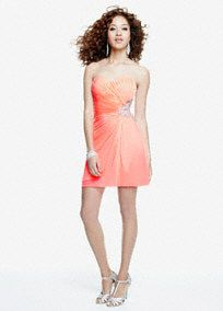 Vibrant and modern, this short jersey cut-out homecoming dress hits all the right notes!  Strapless sweetheart bodice features eye-catching three strap cut-out detail at back.  Sparkling beaded side adds a glamorous touch.  Short matte jersey fabric is comfortable to wear all night long.  Fully lined. Side zip. Imported polyester. Professional spot clean.