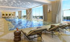 Awesome Beautifully Residential Indoor Pool Design With Chic Floral Pool Floor Tile And Adorable Sun Chairs With Unique Tea Tables Also Nice Ceramic Floor Tile And Sparkling Ceiling Lights And Large Windows