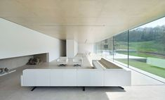 minimal-white-extension-to-traditional-british-home-14-living-area-long.jpg