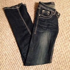 MISS ME look alikes ! Practically new They look exactly like miss me's! Has bedazzled pocket. Dark wash with lighter parts. Only worn once- not my size. The denim is nice and has some give to it so makes them super comfy and flattering ! Bought for $100. Look alike to miss me ! Miss Me Jeans