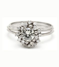 Retro Cocktail Ring.This eye-catching starburst retro diamond cocktail ring has the blooming height and sparkle to stand out for any occasion! We also adore the fact that this 14K white gold vintage ring is fashioned with mulitple bands. Size 8.5 vintage jewelry, vintage diamond ring, vintage engagement ring, starburst vintage ring, cocktail ring, diamond cocktail ring