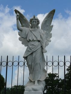 In Thomas Wolfe's book 'Look Homeward, Angel', he references an angel statue carved from Italian marble.  The statue was sold to a Henderson County family and is now enclosed in an iron gate in Oakdale Cemetery in Hendersonville, NC - Google Search