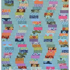 Tula Pink quilt - cobblestones like wobbly coin stacks :) fabric focus