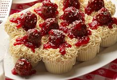 SPAGHETTI & MEATBALLS CUPCAKES - All you need are a few piping skills—to pipe out the spaghetti shaped frosting—and the ability to dunk a Ferrero Rocher chocolate into some strawberry jam.